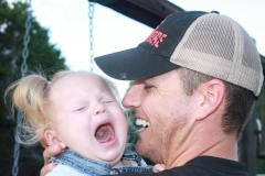 Daddy let the swing smack me in the face!!!