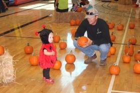 Landri & Daddy picking out a pumpkin