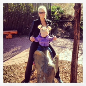 Riding the elephant statue with Mommy!
