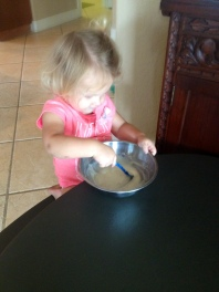 Cookies - Stirring the icing!