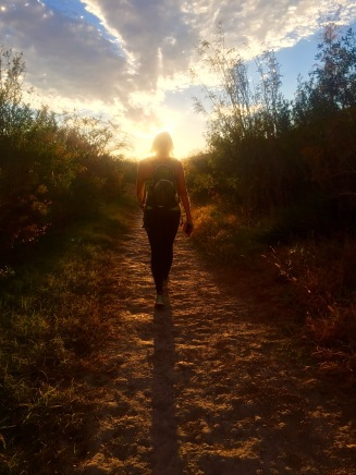 Megan walking out of Boquillas at sunset